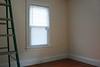 The back bedroom has three windows.