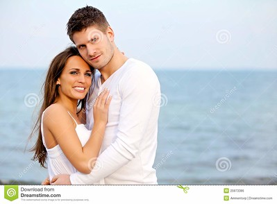 //www.dreamstime.com/royalty-free-stock-image-romantic-couple-posing-beach-image25973386