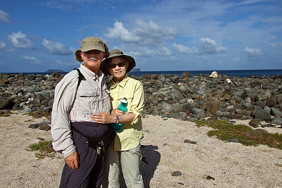 "Phyllis and Bill on Genovesa Island in the Galapagos in 2007.  Our Bio: We are Phyllis and Bill Crowley, amateur photographers who live near Salt Lake City, Utah.  Bill is on the faculty of the University of Utah Health Sciences Center, and began photographing as a serious hobby in the mid-1990s.  Bill is very appreciative of his initial photography teachers, Bill Fortney and Cliff Zenor, of the Great American Photography Workshops.  Phyllis is a Registered Dietitian and the Utah State Nutrition Coordinator for the Women, Infants and Children Program.  While living in Memphis, Tennessee, where Phyllis was born and lived most of her life, we took many of our summer vacations in the West, which is when we began to explore Utah and its magnificent landscapes.  Phyllis would always join Bill on his photography treks because she enjoyed hiking.  On a vacation to Mt. Denali, they both met the guest photographer, George Lepp, who provided Bill with an overall approach to nature photography.  It was on this vacation, that Phyllis began to develop an interest in photography, especially after an all day trek up and down the main road in Denali National Park, photographing grizzly bears, caribou, moose and Mt. Denali reflections.  George Lepp, who is very personable and an outstanding instructor, began to first inspire Phyllis about the basics and joy of photography, though she had not picked up a camera at this time.  After moving to Utah in 1999 and some years later, while hiking in the beautiful parks and canyons of Utah, Phyllis began to ask Bill, and quite often, ""may I use your camera for a minute and compose this beautiful scene?"".  Well, after just a few hikes of this, Bill said, ""we're getting you a camera of your own!""  So, in about 2004, Phyllis had her own camera equipment and they both embarked on a journey that became a passion for hiking and photographing in the beautiful Wasatch and Uinta mountain ranges outside of Salt Lake City.  These mountain ranges provided snowscapes in the winter, roaring streams in the spring, profuse wildflower explosions in the summer and aspen extravaganzas in the fall.  They have become totally captured by the unique red rock landscapes of the Colorado Plateau in southern Utah, and adjacent areas of Arizona, Colorado and New Mexico.  They particularly enjoy searching for and photographing the ancient Native American ruins and rock art that are concentrated in this region.  Phyllis and Bill have made wonderful friends and benefited greatly from outings with photographers such as Jackson Bridges, Gary Ladd, Steve Burger, Colleen Miniuk-Sperry, Jon Fuller, Tom Till, Greg Basco and Jose Vargas.  These outstanding professional photographers have mastered approaches to capturing the beauty of landscapes and wildlife while being so gracious to us in sharing their knowledge, photography expertise and joy of capturing images in the field.  For many years, Phyllis was attached to her Fuji camera, but has now upgraded, with Bill, to a Nikon digital SLR and they both enjoy extending the creative process from image capture in the field to image optimization with Photoshop at home.  Recently, they have been using High Dynamic Range (HDR) to better capture as much detail as possible in every image.  They hope this web site will provide the means for sharing images and the joy they experience when they encounter the beautiful creations of God.  We partner with Framer's Nook (www.framersnook.com) as a local retail site for expert matting and framing of our prints.  All images in our galleries on the SmugMug site are owned and copyright (c) by Phyllis and William Crowley."