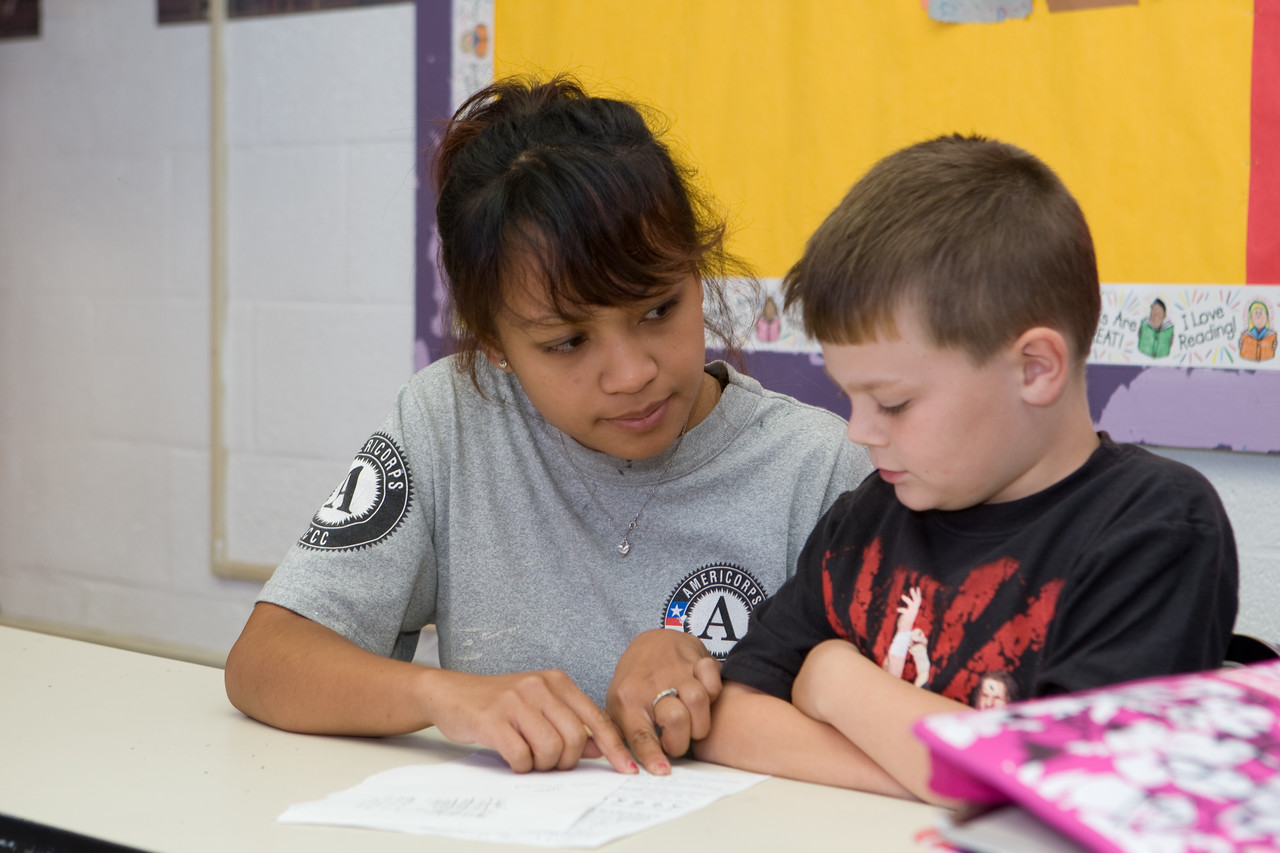An AmeriCorps member works with a child at the Academy of Success Youth Development Center in Baltimore, MD.