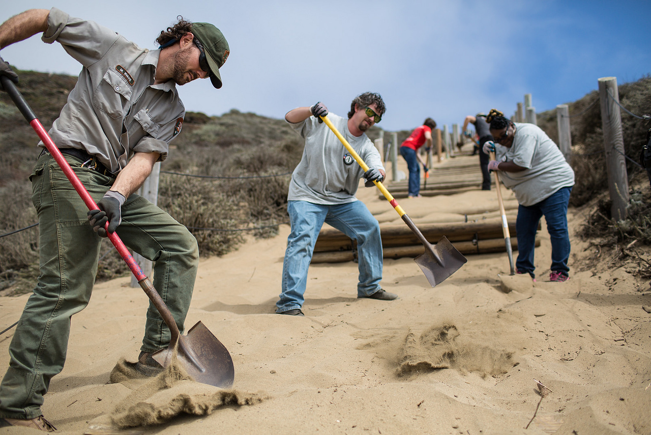 AmeriCorps members and National Park Rangers serve on the 20th Anniversary of AmeriCorps in San Francisco. Corporation for National and Community Service Photo.