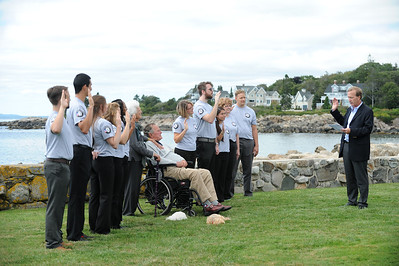 President George H.W. Bush participates in an AmeriCorps pledge ceremony at his home in Kennebunkport, Maine, one of 100 pledge ceremonies taking place across the country to mark AmeriCorps 20th anniversary and kick off a year of service for 75,000 AmeriCorps members.   Neil Bush, chairman of Points of Lights, administers the AmeriCorps pledge to Maine AmeriCorps members. Corporation for National and Community Service Photo.