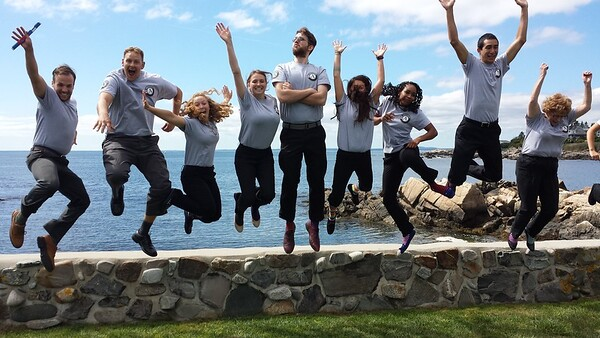 AmeriCorps members attending pledge ceremony at President George H.W. Bush's home in Kennebunkport, Maine, jump for joy. Corporation for National and Community Service Photo.