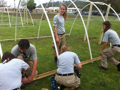 Amanda Polhamus, Justin Farley, Catherine Terwilleger, Katy Willis, and Lauren Hart building a greenhouse. AmeriCorps NCCC. Corporation for National and Community Service Photo.
