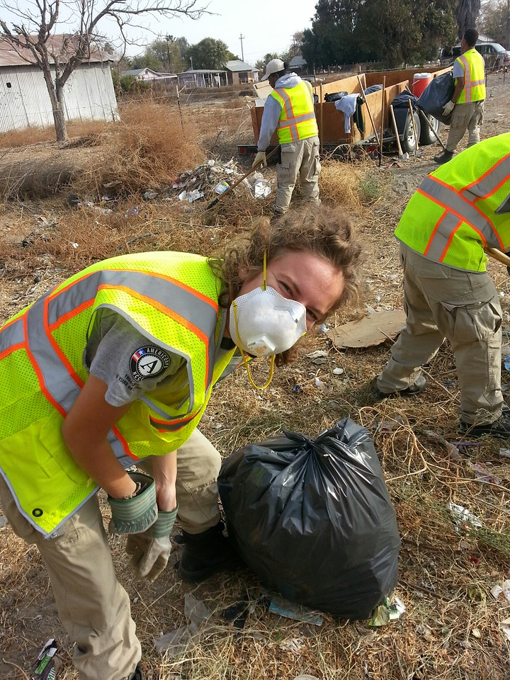 Corps members clean up the trash in the alleyways of Alpaugh, CA as part of the ongoing effort to restore the community. AmeriCorps NCCC. Corporation for National and Community Service Photo.