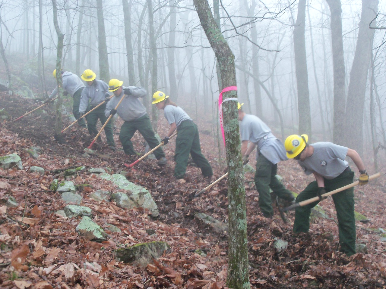 Steven Delsuc, Amanda Takemura, Sam Deere, Nathalie Besse, Maxwell Maloney and Benjamin Wiley putting in a handline for a prescribed burn AmeriCorps NCCC. Corporation for National and Community Service Photo.