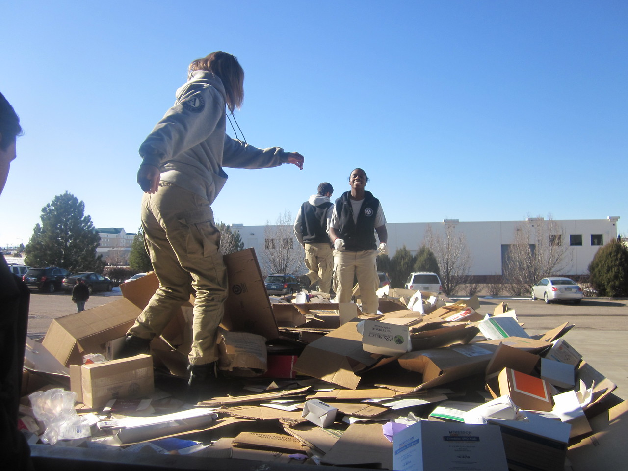 E7 r1 project cure Earth 7 prepares boxes for recyling in Denver during Round 1 of Class 18. AmeriCorps NCCC. Corporation for National and Community Service Photo.