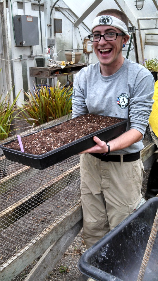 Jyler is excited about learning how to plant! AmeriCorps NCCC. Corporation for National and Community Service Photo.