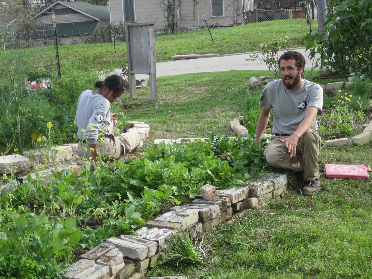 Mona Al-Abadi and Chris Corrigan working at a community garden for Earth 7's Day of Service AmeriCorps NCCC. Corporation for National and Community Service Photo.