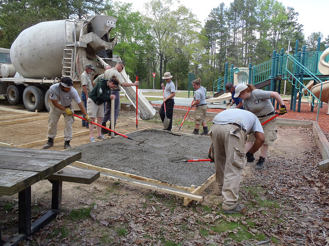 Fei Chen, Sarah Foster, Ethan Blatt, Jillian Zingale, Anna Cox, and Sam Deere spreading concrete. AmeriCorps NCCC. Corporation for National and Community Service Photo.