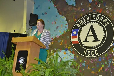 Dr. Audrey Casserleigh, NCCC Class 1 alum, speaks to the Corps before taking the pledge.