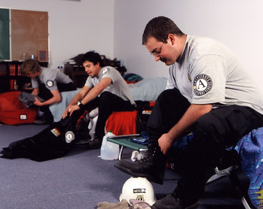 AmeriCorps members lace up their boots and pack up their gear before heading out for the day's assignment. Corporation for National and Community Service Photo.