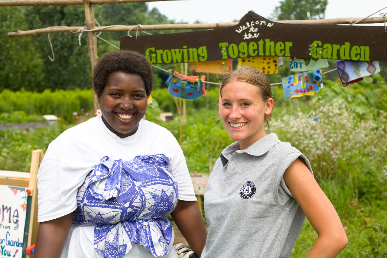 An AmeriCorps VISTA member celebrates with a community volunteer at the opening day of a Vermont-area community garden. Corporation for National and Community Service Photo.