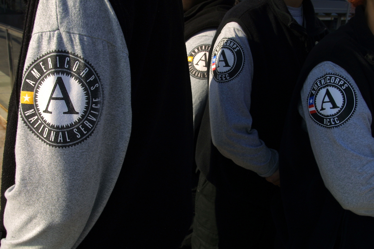 AmeriCorps members proudly display the AmeriCorps logo. Corporation for National and Community Service Photo.
