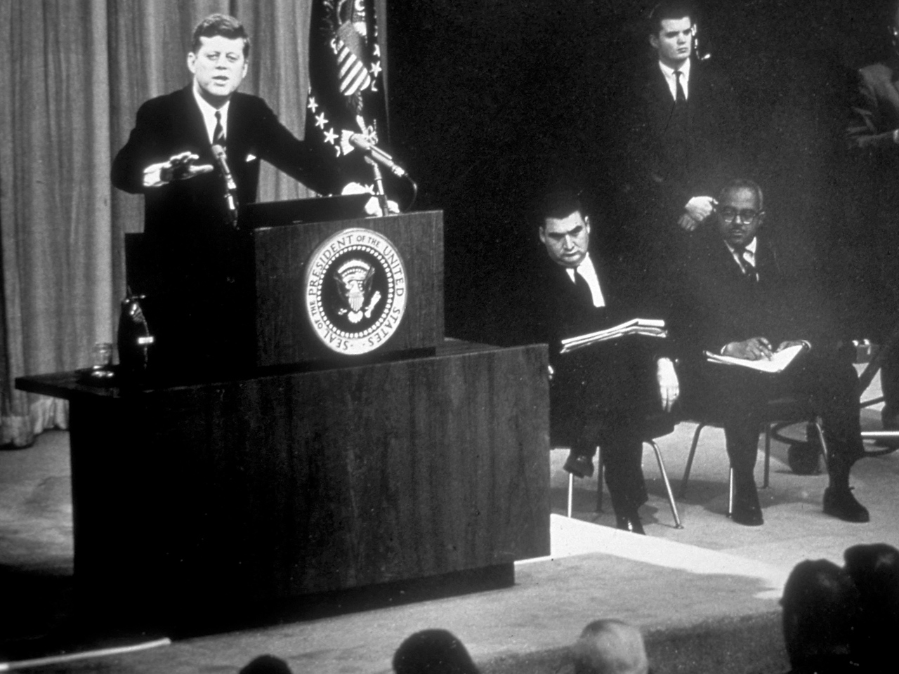 "The VISTA program was first envisioned by President John F. Kennedy to serve the needs of the poorest Americans. In his January 1963 State of the Union Message, President Kennedy suggested a national service corps to serve ""our own community needs in mental health hospitals, on Indian reservations, in centers for the aged and young delinquents, in schools for the illiterate and handicapped."" (© 1963 Corporation for National and Community Service - Office of Public Affairs)"