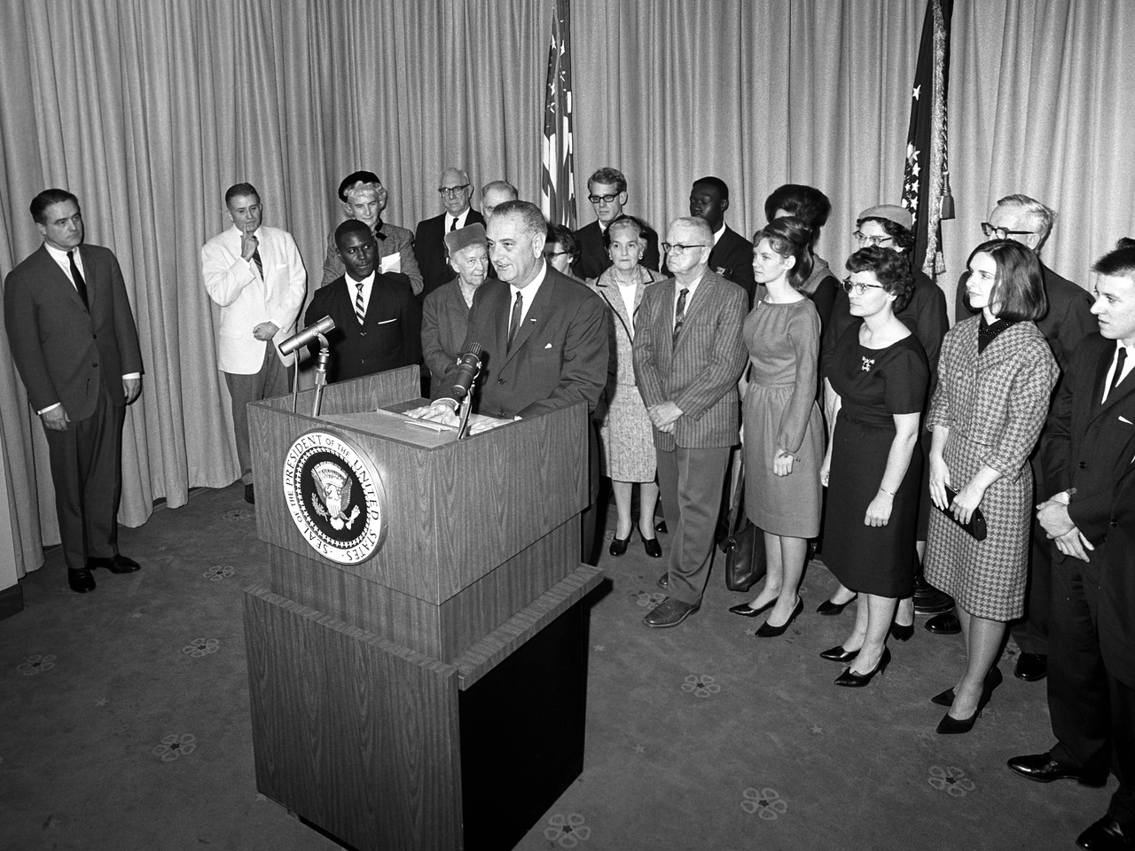 """On December 12, 1964, President Lyndon B. Johnson welcomed the first group of 20 VISTA volunteers with this advice: """"Your pay will be low; the conditions of your labor often will be difficult. But you will have the satisfaction of leading a great national effort and you will have the ultimate reward which comes to those who serve their fellow man."""" (© 1964 Corporation for National and Community Service - Office of Public Affairs) Corporation for National and Community Service Photo."""