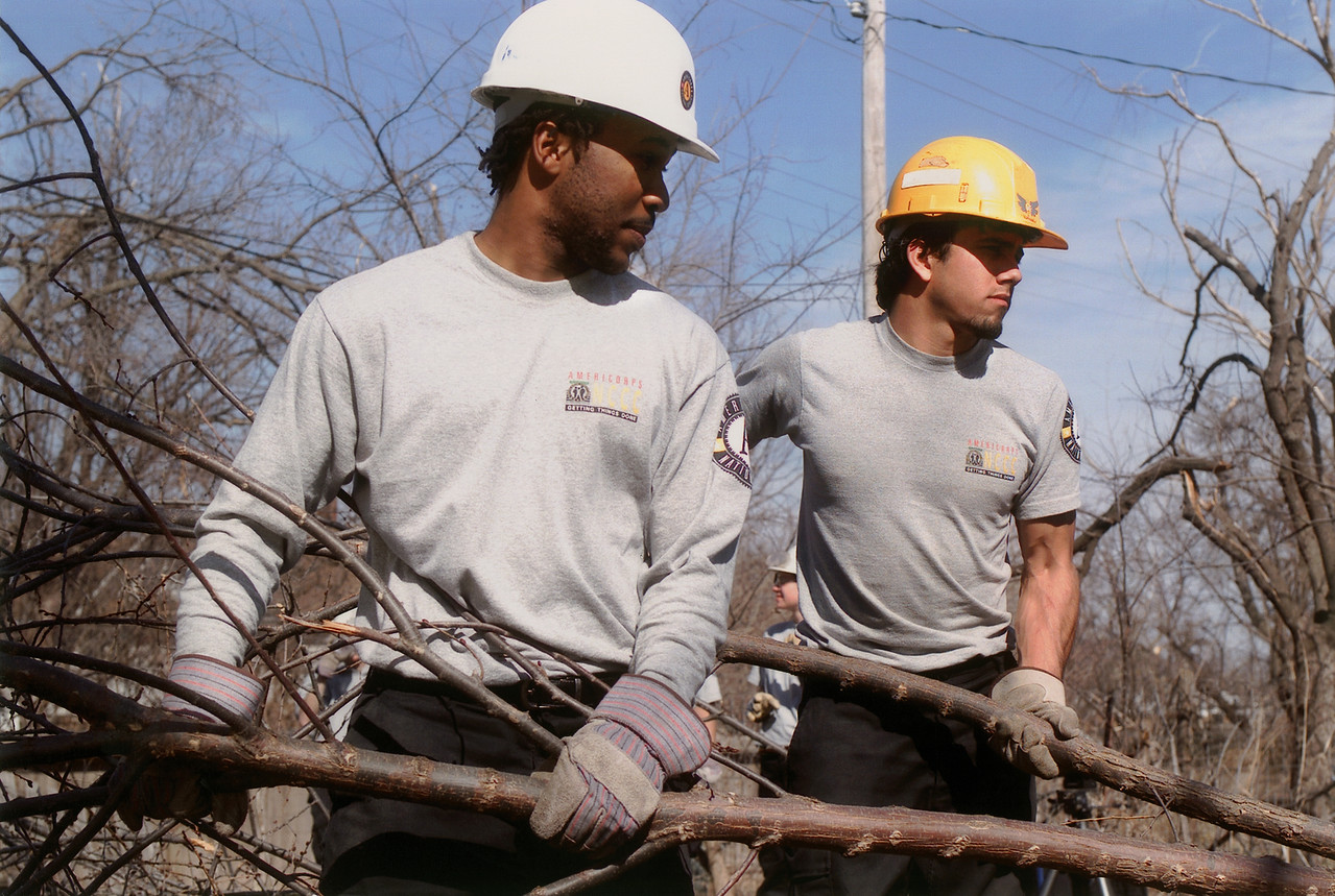 AmeriCorps NCCC members wear hard hats as they clear debris during a project. Corporation for National and Community Service Photo.