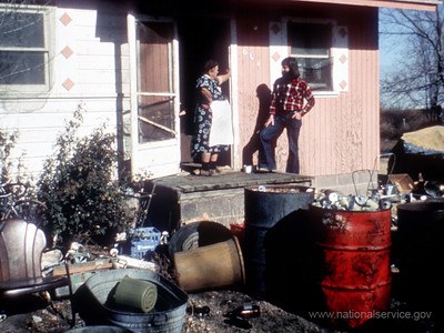 VISTA member Ned Murray discusses a housing problem in 1974 with a resident in this Laurel, Kansas, community in an effort to get the family into more comfortable and healthy quarters. (© 1974 Corporation for National and Community Service - Office of Public Affairs)