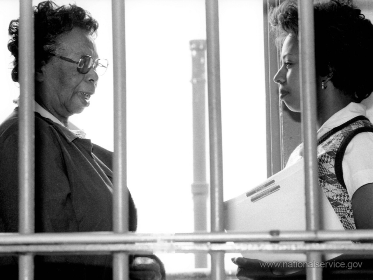 Assigned to the Missouri Division of Corrections in July 1980, VISTA member Rose T. Evans, 69, counsels inmate Linda Jack at Renz Correctional Center in Cedar City. Evans, a retired school teacher, recruits and trains community volunteers and inmates to provide activities in music, dance, sewing, crafts, cosmetology, and correspondence for the prisoners. (© 1980 Corporation for National and Community Service - Office of Public Affairs)