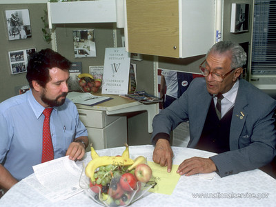 In 1986, VISTA members Alejandro Cruz and James Campbell plan activities for the Vietnam Veterans Leadership Program in New York City. (© 1986 Corporation for National and Community Service - Office of Public Affairs)