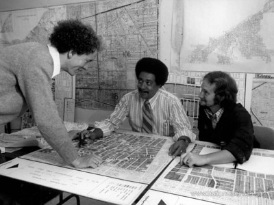 In October 1973, VISTA volunteers Steve Roberts (left) and Thomas J. Van Dalen (right) review a map of the Hough area of Cleveland, which they prepared to indicate the condition of every building in the area. (© 1973 Corporation for National and Community Service - Office of Public Affairs)