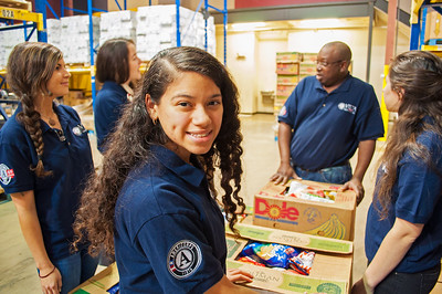 AmeriCorps VISTA members working on a service project with the Capital Area Food Bank in Austin, TX.