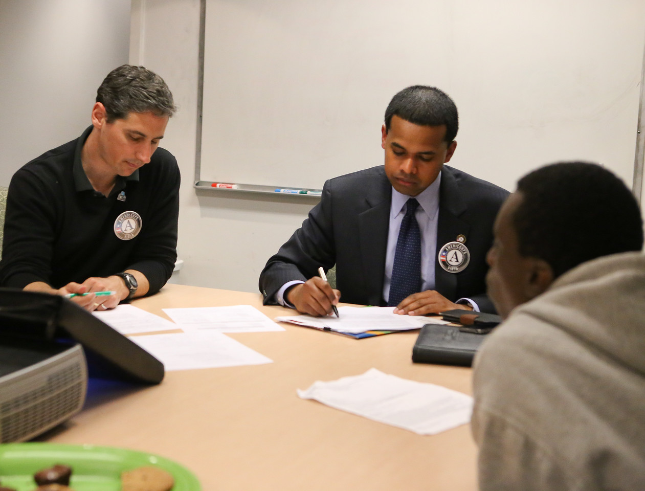 Director of Volunteer Management Matt Thornton, Higher Achievement with VISTA Director Paul Monteiro assisting a student scholar on an upcoming speech. Corporation for National and Community Service Photo.