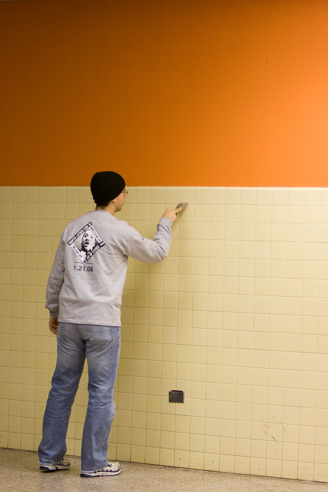 A lone volunteer paints a wall in the cafeteria at Theodore Roosevelt High School in the District of Columbia during a service project on Martin Luther King Day. About 20,000 people in the District of Columbia participated in nearly 150 service projects in honor of the slain civil rights leader on January 21, 2008.