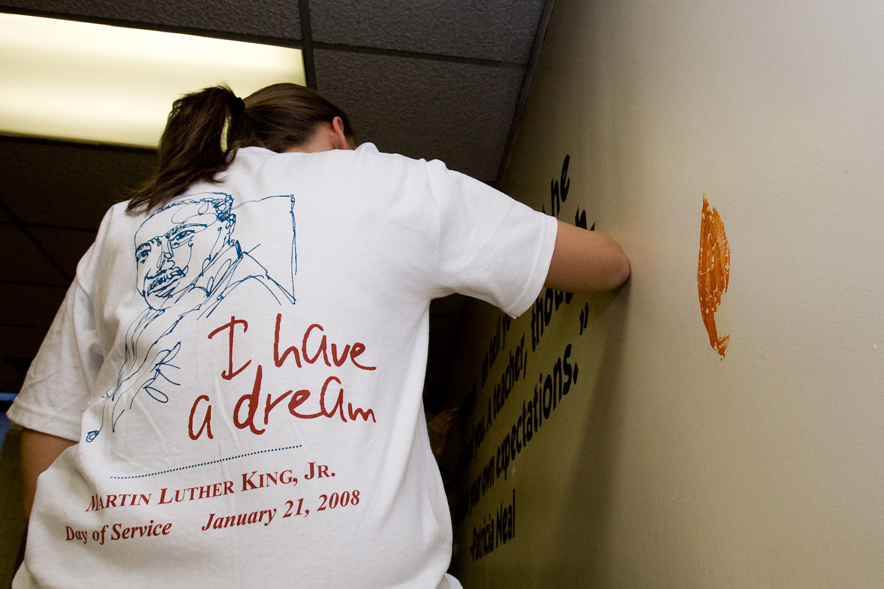 A volunteer's T-shirt reflects her commitment to the teachings of Martin Luther King as she participates in a 2008 King Day of Service project at Theodore Roosevelt High School in Washington, D.C. About 20,000 people in the District of Columbia participated in nearly 150 service projects in honor of the slain civil rights leader on January 21, 2008.