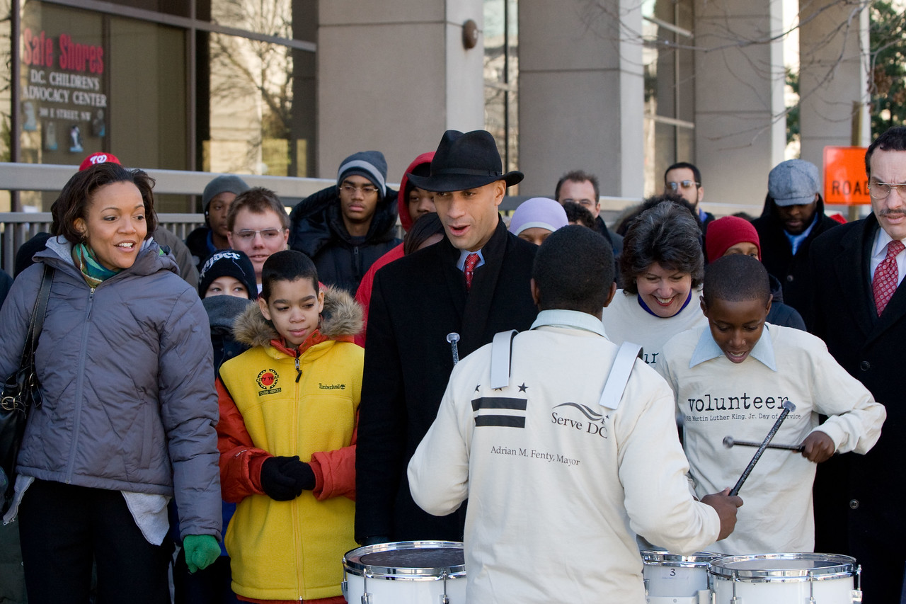 Millicent Williams, executive director of Serve DC, Washington, D.C. Mayor Adrian Fenty, and Councilwoman Carol Schwartz, left to right, participate in the march to the Community for Creative Nonviolence as young musicians perform. About 20,000 people in the District of Columbia participated in nearly 150 service projects in honor of the slain civil rights leader on January 21, 2008.