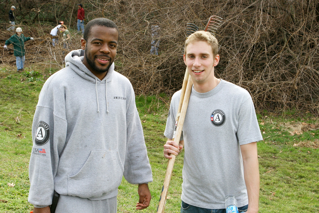 AmeriCorps members Eric Jones, left, and Peter Vincent, right, spent the Martin Luther King, Jr., Day of Service participating in a clean-up project of the Anacostia River in Southeast Washington, D.C.   Hundreds of thousands of Americans, including President George W. Bush, honored Dr. King by engaging in volunteer service projects across the United States.