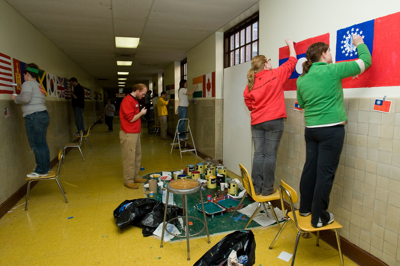 Volunteers paint flags from various countries in a hallway at Theodore Roosevelt High School in the District of Columbia during a service project on Martin Luther King Day. About 20,000 people in the District of Columbia participated in nearly 150 service projects in honor of the slain civil rights leader on January 21, 2008.