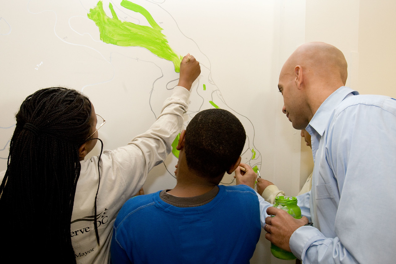 Mayor Adrian Fenty joins volunteers in painting a mural during a service project at the Community for Creative Nonviolence in Washington, D.C. About 20,000 people in the District of Columbia participated in nearly 150 service projects in honor of the slain civil rights leader on January 21, 2008.