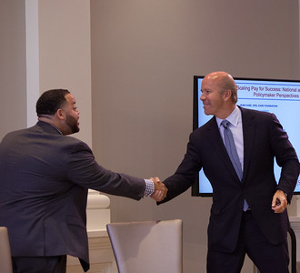 Director of SIF, Michael Smith welcomes Rep. John Delaney (MD) on stage at the Pay for Success Grantee Announcement at Halcyon House in Washington, D.C. Corporation for National and Community Service Photo.