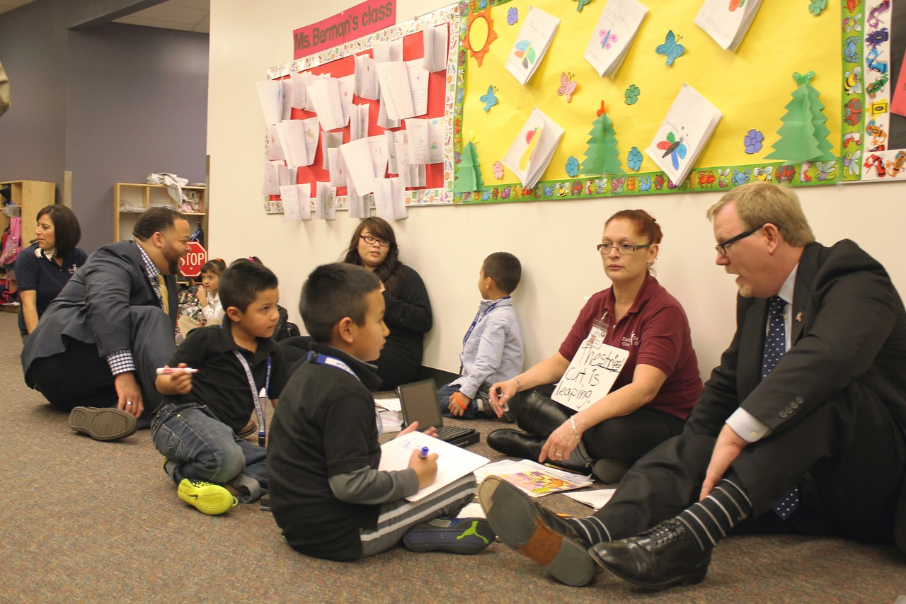 SIF Grantee: Mile High United Way – Subgrantee: Denver Public Schools /Each One Teach One program – Michael learning with the children of Each One/ Teach One. Corporation for National and Community Service Photo.