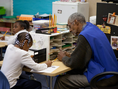 FGP, Percy Thomas tutoring third grader at Miner Elementary school in Washington, D.C. Corporation for National and Community Service Photo.