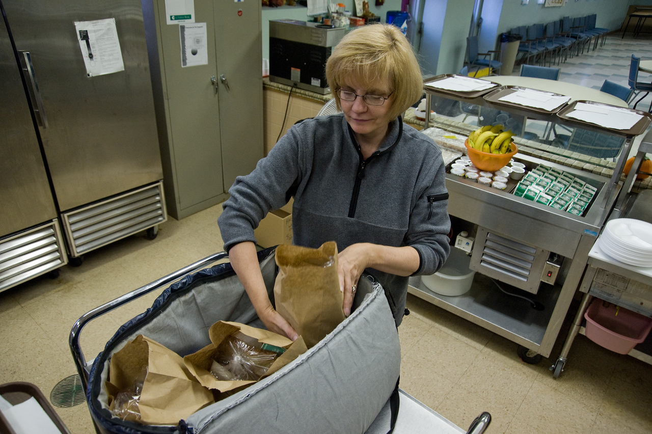 RSVP volunteer Peggy Walsh packs home delivered meals at the Havertown Senior Center in Haverton, PA on<br /> October 29, 2008.