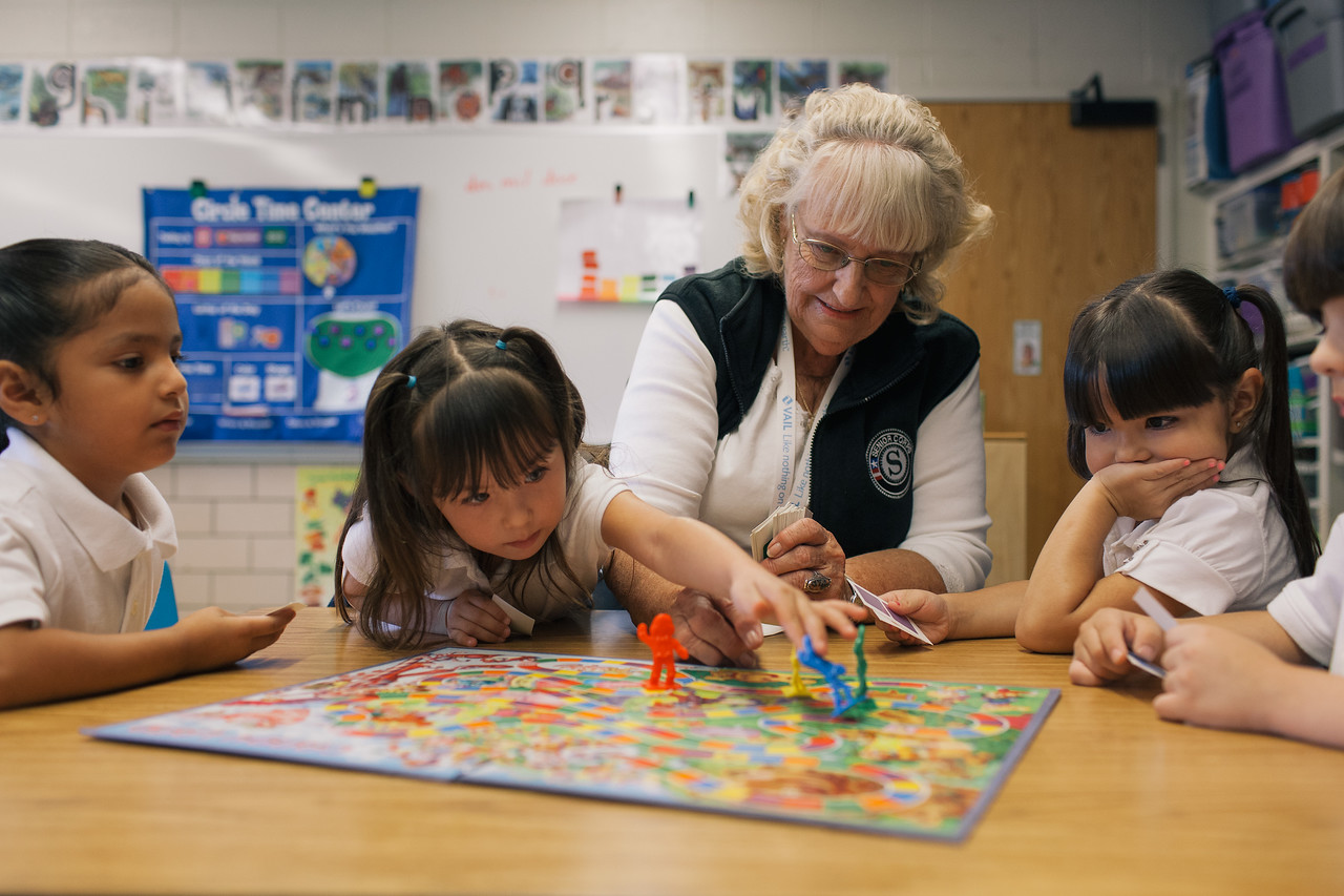 Foster Grandparent Grandma Emma works with on letter recognition with Pre-K students from Francis M.Day School in Denver, CO.