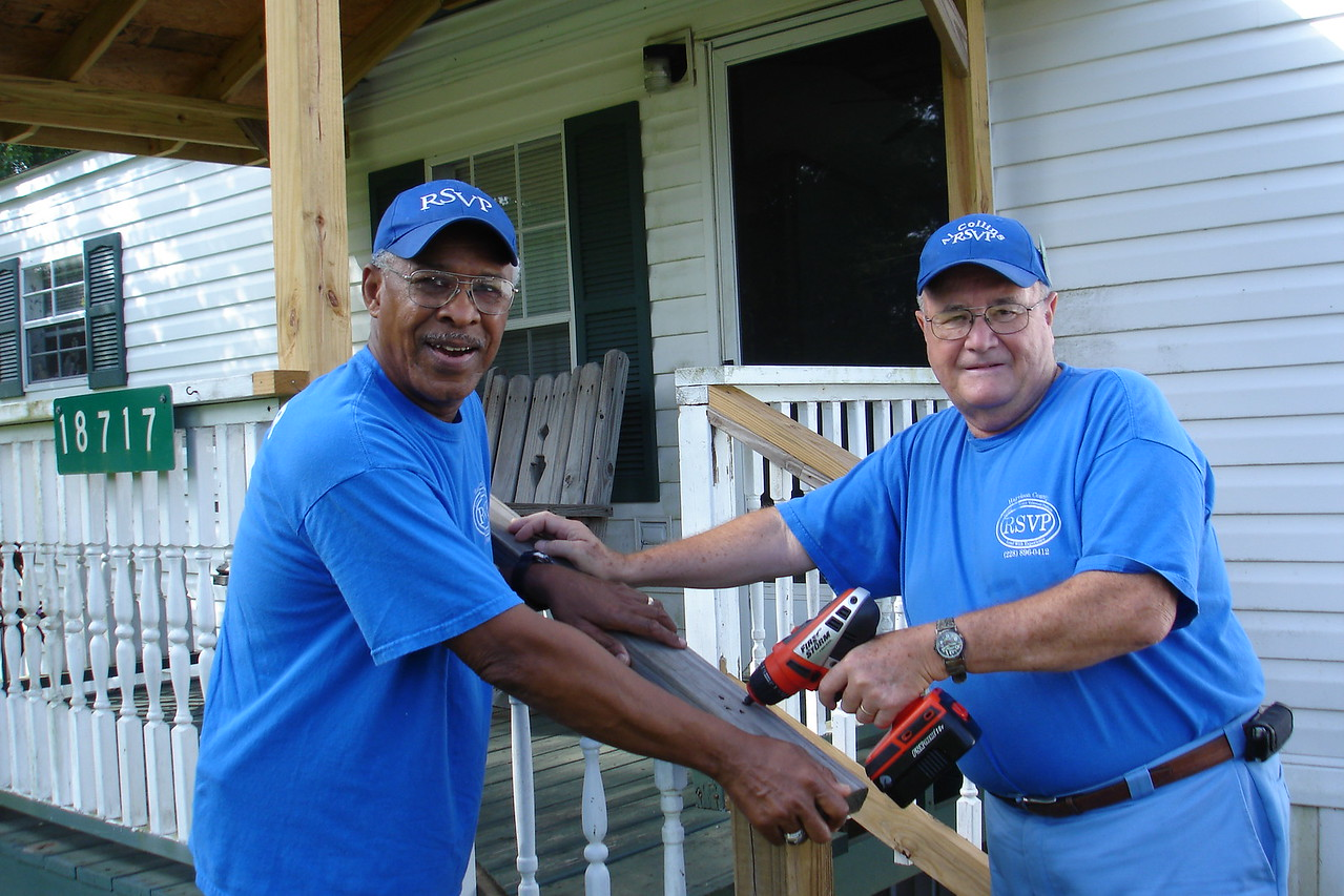 """Volunteers from the Harrison County RSVP """"Handyman Brigade"""" reinforce a front porch for a client in Gulfport, MS."""