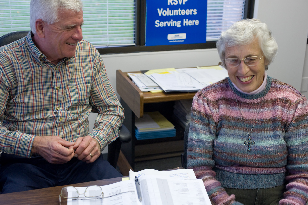 On October 28, 2008, RSVP volunteer Medicare counselor Ralph Bozorth helps client Arlene Dewalt with Medicare<br /> questions at the RSVP Headquarters in Blue Bell, PA.