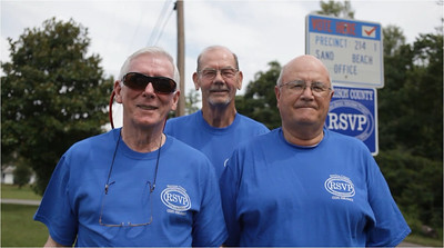 "Volunteers from the Harrison County RSVP ""Handyman Brigade"" stand proud after a full day of lending a hand to help fix the homes of handicapped and elderly residents in Gulfport, MS."