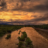 Photo #263 of 365 - Sun sets on the rain filled Rillito River in Tucson, Arizona