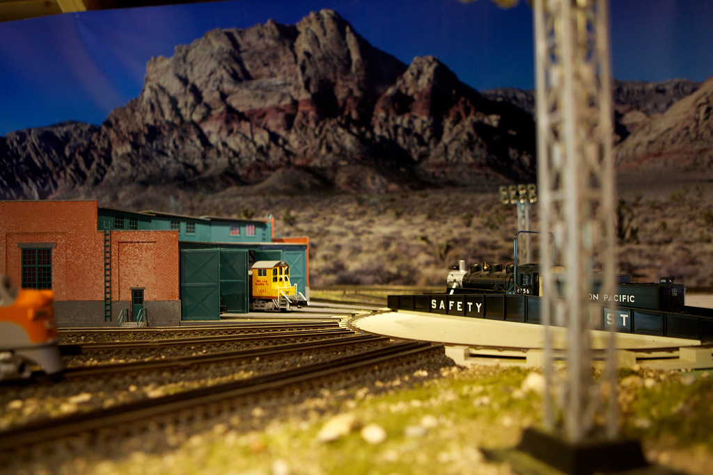 "This image is of the Roundhouse on the Sandquist Railway-more images can be found here: <a href=""http://www.sandquistphotography.com/Trains/Sandquist-Railway/"">http://www.sandquistphotography.com/Trains/Sandquist-Railway/</a>. Last week we installed the mountain backdrop. Slowly its starting to come together. <br /> <br /> Day 83 of 365<br /> 03-24-2013"