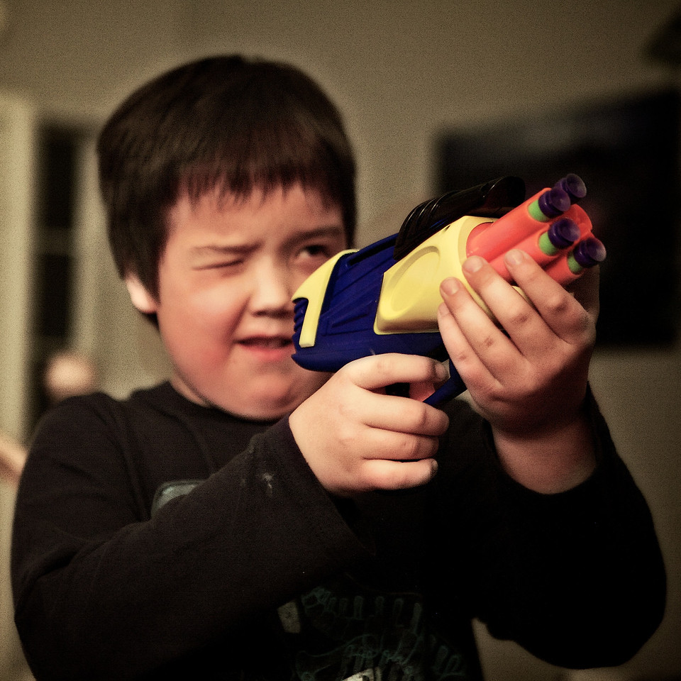 Today is Reece's 8th birthday.... And he really wanted a Nerf suction cup gun! This was his idea for todays photo! <br /> <br /> Day 58 of 365<br /> 02-27-2013