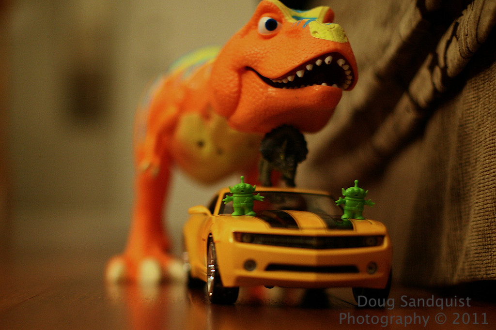 Ok... So the Triceratops some how found his way on to the roof of the Camaro, only to find not one but two Martians inside the car... Of course they were terrified and jumped on the hood of the car to get away. But little did they know, that T-Rex was ready to gobble all of them up! :)<br /> <br /> Yes... I got some help from Reece for this photo! Thanks Reece!  <br /> <br /> 02-09-2011