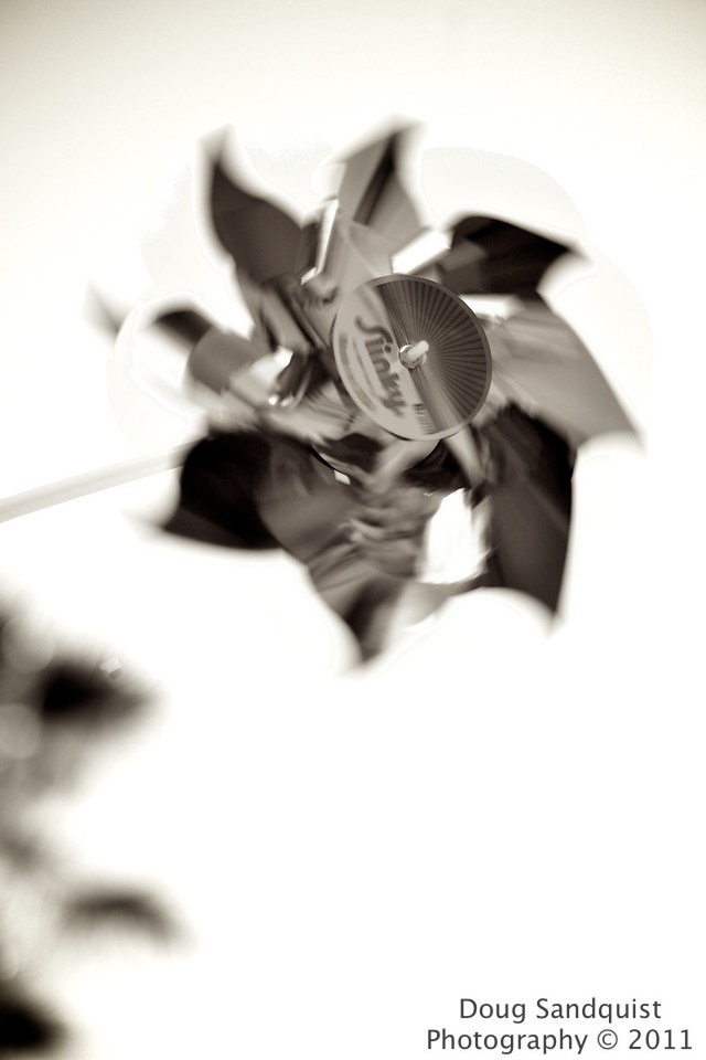 Sure been in a B&W/sepia kind of mood lately!... This is one of J's pinwheels. I had fun trying to capture it amongst brief puffs of wind!   <br /> <br /> 06-07-2011