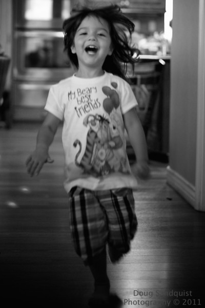 Who remembers running through the house with reckless abandon? I sure do and my kids have fun making those memories! Luckily I sort of captured this moment.. This is slightly cropped from the original and sharpened a touch and there was very little chance of catching her face in focus at 1.8! but I liked the joy anyways... <br /> <br /> 07-25-2011