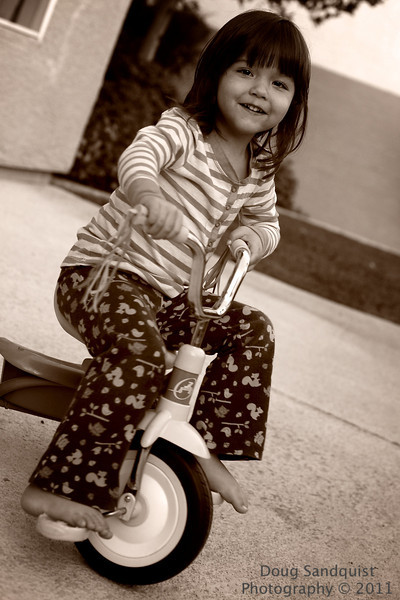 J wanted a pic on her tricycle today... so here it is! I somehow caught a nice smile as of course I couldn't get her to sit still!  I did have to crop this image a bit. I think it's cute!<br /> <br /> 10-04-2011