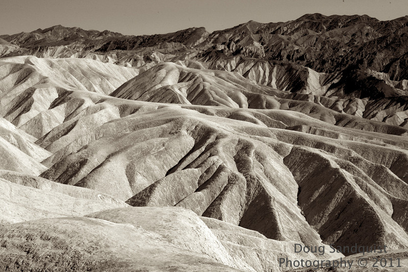 Took a day trip to Death Valley today. Been a very long time since I'd been there. Probably over 25 years in fact. I didn't remember much. I hope to have a Gallery up by tomorrow, i'll  post a link when I get the gallery ready... This is at Zabrisky Point... the actual Zabrisky point is just to the right of this image. Guess this is where all the Borax mines are located. Had a great day overall... Had fun on the Salt Flats of Badwater, the lowest elevation in the United States, at -282. No need for a reflector there!.. I took pictures at high noon and the faces were adequately lit! :) Oh and gas at Furnace Creek is $5.75 for regular, and $5.96 for premium! <br /> <br /> 04-30-2011