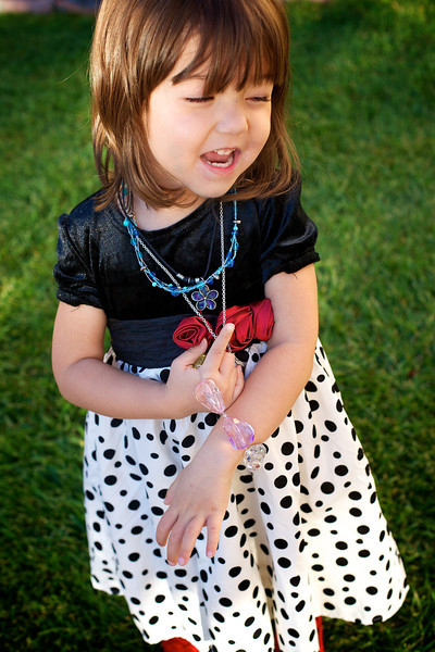 J was really excited to get all dressed up this morning even though she wasn't feeling well... She felt well enough to dance in the grass! I really liked the early light... <br /> <br /> 10-22-2011